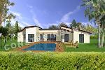 villa moderne avec une piscine et des baies vitrées